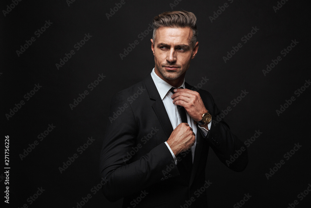 Fototapeta Handsome confident businessman wearing suit