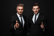 Leinwandbild Motiv Two confident handsome businessmen wearing suit