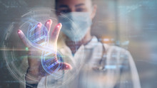 Portrait Of A Woman Doctor Is Using A Futuristic Latest Innovative Technology For Viewing Samples Of DNA With Augmented Reality Holograms In A Laboratory.
