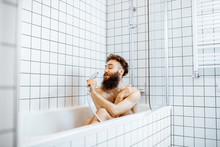 Joyful Bearded Man Washing In ...