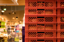 Red Bread Crates Stacked In A Supermarket.