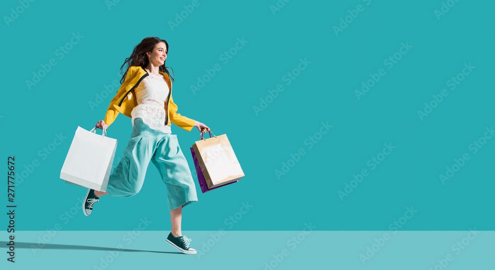 Fototapety, obrazy: Cheerful happy woman enjoying shopping