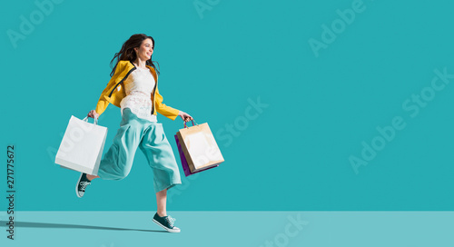 Cheerful happy woman enjoying shopping - fototapety na wymiar