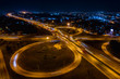 Leinwanddruck Bild - interchange freeway high way motorway and ring road transportation logistics connect in the city with lighting the city background