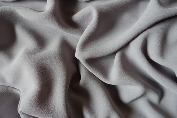 Folded grey crepe georgette fabric from above