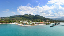 Panorama Of Tropical Resort Amber Cove With Pier For Cruise Ships  And Resort On Sunny Day
