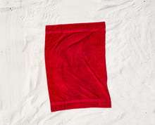 Aerial View Of Red Towel On Beach