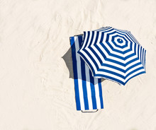 Aerial View Of Summer Towel And Umbrella On Beach