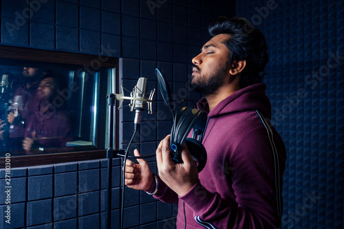 Fototapeta professional singing indian men headphones sound modern studio violet background recording song