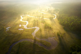 Fototapeta  - Misty morning river in sunlight. River landscape aerial view. Riverside view from above. Summer nature in sun rays. Drone view on  sunny nature. Scenery river top view.