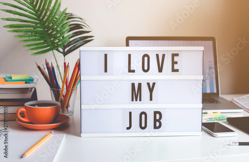 Fotografia I love my job concepts with text on light box on desk table in home office