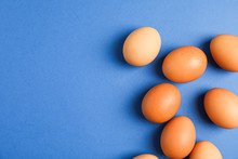 Flat Lay Composition With Chicken Eggs On Color Background, Space For Text