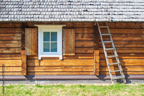 Old lithuanian wooden house in Vilnius, Lithuania with sky and nature