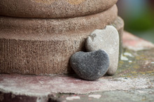 Closeup Of Stone In Shaped Heart On Stoned Wall In Outdoor - Love Concept