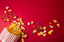Popcorn Bag With Chocolate Candy Background