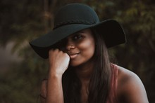 Smiling Woman Wearing Black Hat