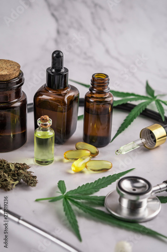 Photo  Assorted cannabis products, pills and cbd oil over medical prescription sheet -