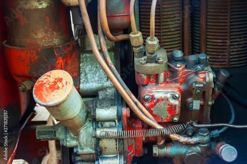 Old messy red vintage tractor engine  Diesel engine air