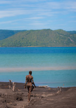 Man Digging To Find Megapode Birds Eggs In Tavurvur Volcano Sands, Rabaul, New Britain Island, Papua New Guinea