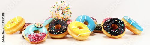 donuts in different glazes with chocolate Wallpaper Mural