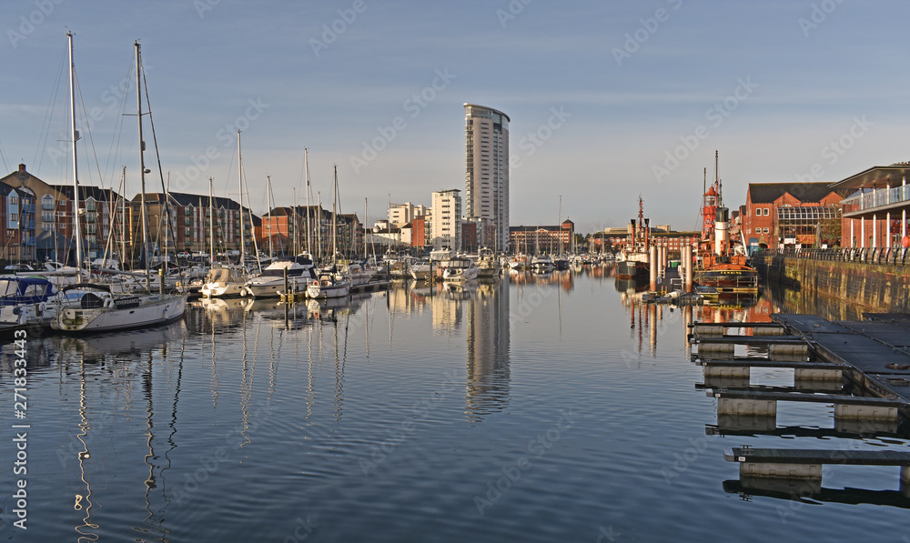 Fototapety, obrazy: Swansea Marina housing, featuring the tallest building in Wales, the Meridian tower, standing at 107m (351ft).