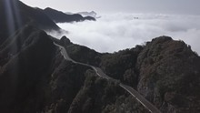 Aerial View Of Clouds Running Over Mountain Road In Anaga Mountain Range, Tenerife, Canary Islands, Spain.