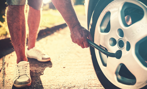 Vászonkép Problem with a car. A broken car on the road. Changing wheel
