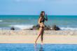 Portrait beautiful young asian woman wear bikini around swimming pool in hotel resort nearly sea ocean beach