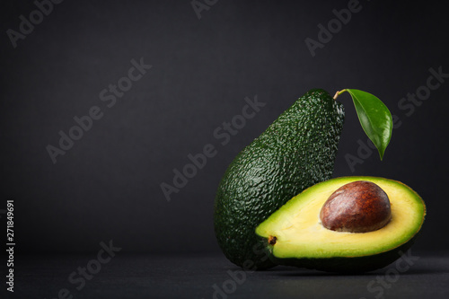 Valokuva Fresh, raw avocado on a black background