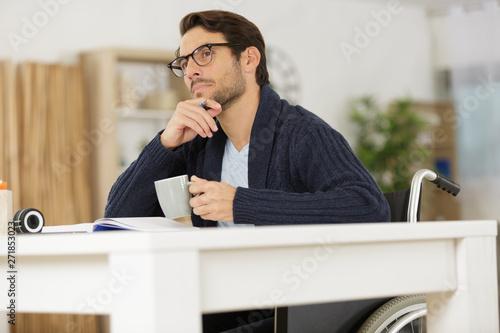 Valokuva  handsome disable man thinking at home