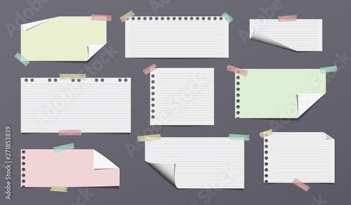 Obraz na plátně  White, colorful and lined note, notebook paper stuck on dark background