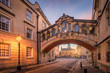 Bridge of sign with the Sheldonian theatre background and street lamp foreground during twilight at Oxford, UK