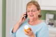 canvas print picture - Senior Adult Woman on Cell Phone Holding Prescription Bottle