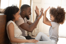 African Kid Daughter Give High-five To Daddy Playing With Parents