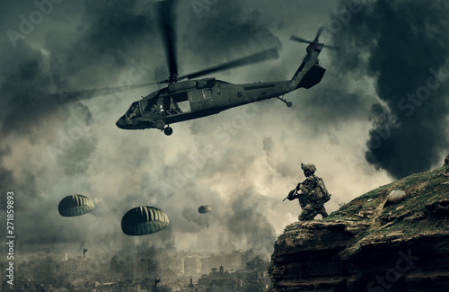 Military helicopter and forces between fire and smoke in destroyed city and soldiers are in flight with a parachute.