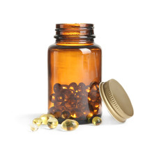 Bottle With Cod Liver Oil Capsules On White Background