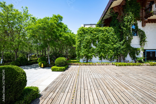 Obraz Wooden floor and house in summer - fototapety do salonu