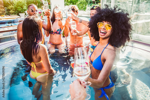 Happy multiracial friends having fun on a pool party on vacation - 271869096