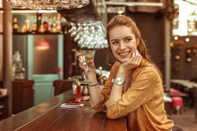 Smiling Woman Holding Martini ...