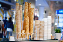 Ice Cream Shugar Waffle Bowls And Cones At Shop In A Mall.  Stacked Up Ice-cream Wafers