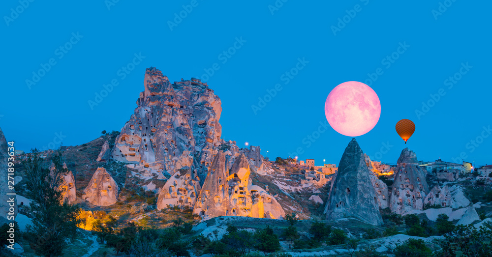Fototapety, obrazy: Amazing view of Uchisar castle in Cappadocia at twilight blue hour - Girls watching moonrise at the hill of Cappadocia