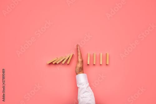 Fotografie, Obraz  Stopping falling dominos