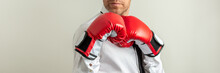 Businessman Wearing Red Boxing Gloves In A Defensive Position