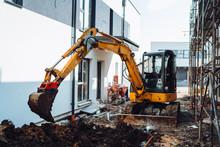 Mini Industrial Excavator Digging On Construction Site