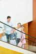 Leinwandbild Motiv Family with two children on escalator