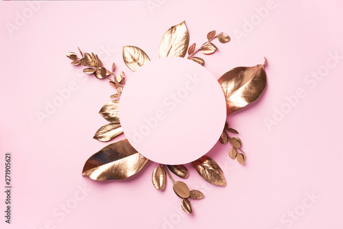 Fotografija Golden leaves on pink background with copy space