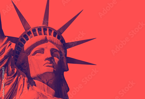 Photo detail of the face of the statue of liberty with a red duo tone effect