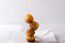 Pouring Honey On The Donut Holes Cooked With Cheese.Delicious Deep Fried Dough Balls With Cheese And Honey