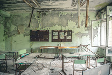 Ruined Class Room With Desks And Blackboards In Pripyat School