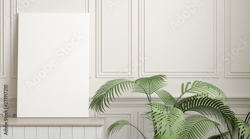 Fotografía  Mock-up of picture canvas frame with small plant in vase on white classic wall